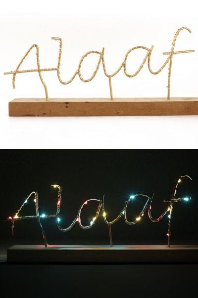 Shelf with text ALAAF illuminated