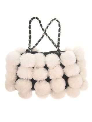 Bag of fur with white balls